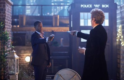 WARNING: Embargoed for publication until 00:00:01 on 03/12/2016 - Programme Name: Doctor Who Christmas Special 2016 - TX: n/a - Episode: The Return of Doctor Mysterio  (No. n/a) - Picture Shows: ***EMBARGOED UNTIL 3rd DEC 2016*** Mr Brock (ADETOMIWA EDUN), Doctor Who (PETER CAPALDI) - (C) BBC - Photographer: Simon Ridgway